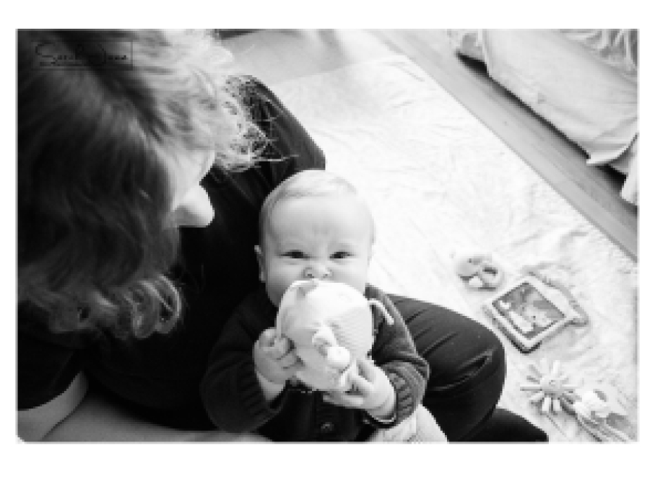 Image of baby chewing on a toy