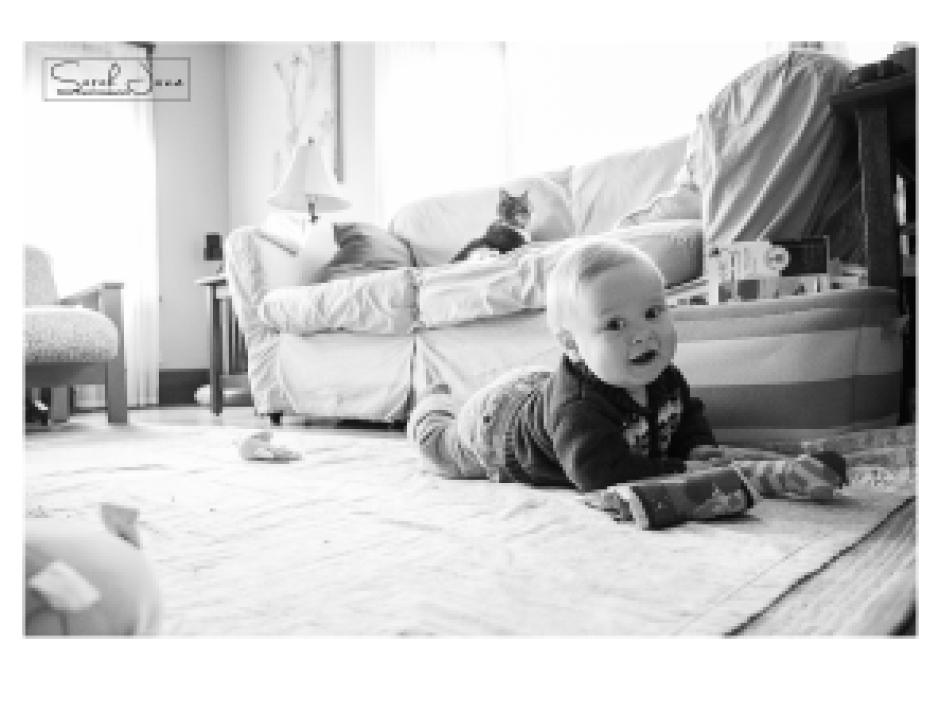 Image of baby on living room floor